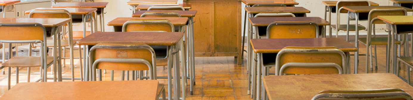 school desks in classroom
