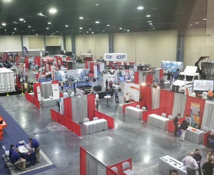 Exhibit hall B with full lighting with LED lights and tradeshow with large vehicles