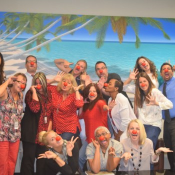 Photo of our staff in recognition of Red Nose day making funny faces