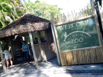 Photo of the ticket hut at zoo entry with a family purchasing tickets