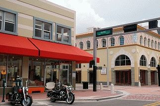 Photo of the Clematis Street with motorcycles and red awning.