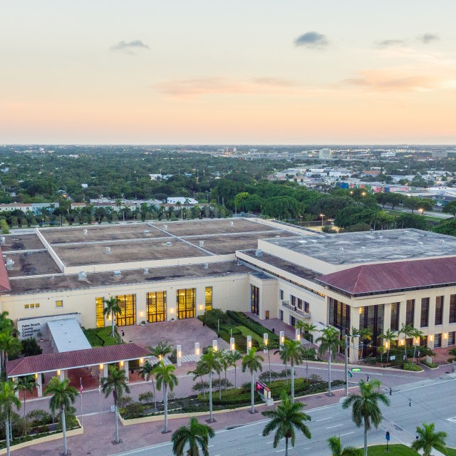 Photo of Front aerial view of the building looking down with sunset in the background